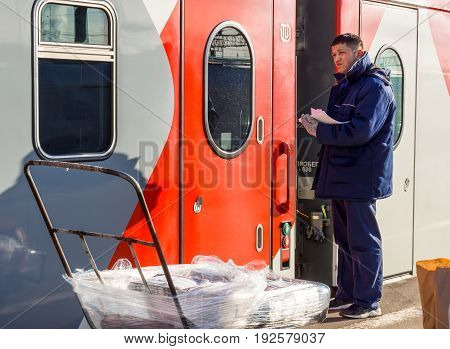 Voronezh, Russia - April 24, 2017: Delivery of the press to the railway car of the train