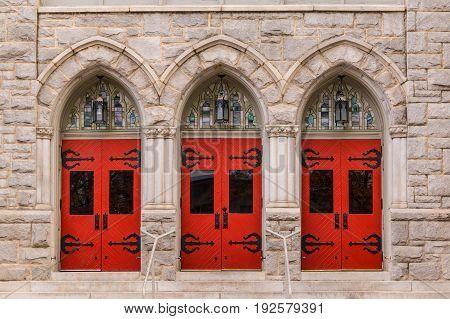 Three doors in a row on the facade of Saint Mark United Methodist Church front view Atlanta USA