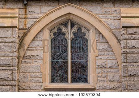 One window on the facade of Saint Mark United Methodist Church front view Atlanta USA