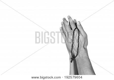 Praying hands. Praying hands with rosary. Black and white. Isolated on white background.