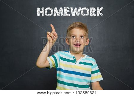 Boy In Front Of School Board With Text Homework