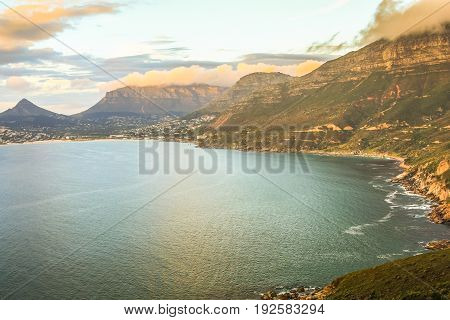 Aerial view of scenic Chapman's Peak Drive at sunset, Cape Town, South Africa is considered one of the most beautiful streets in the world.