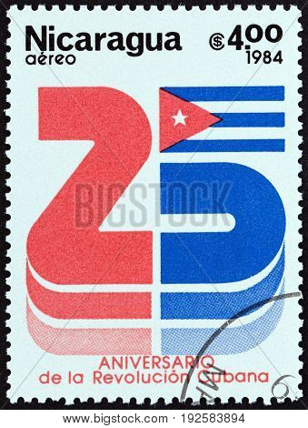 NICARAGUA - CIRCA 1984: A stamp printed in Nicaragua issued for the 25th anniversary of Cuban Revolution shows number 25 and the Cuban Flag, circa 1984.