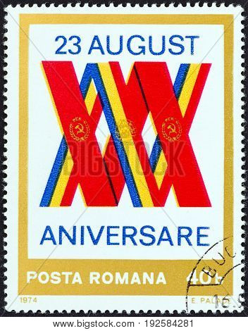 ROMANIA - CIRCA 1974: A stamp printed in Romania issued for the 30th anniversary of Liberation shows Romanian and Soviet Flags as XXX, circa 1974.