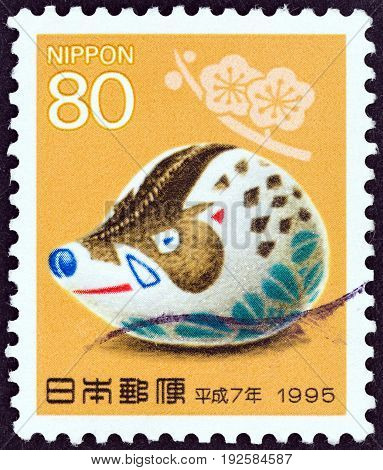 JAPAN - CIRCA 1994: A stamp printed in Japan shows Boar, Takayama soft toy (Year of the Rat, 1996), circa 1994.