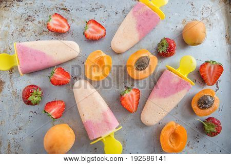 home made popsicles with apricot and strawberry