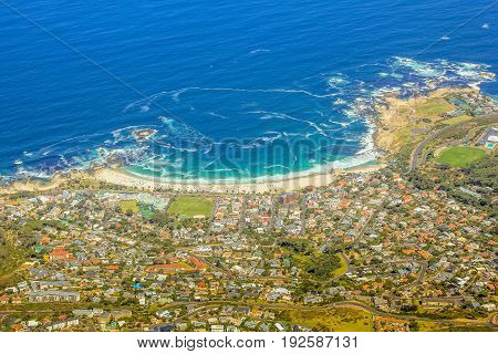 Aerial view of Camp's Bay Beach near Cape Town as seen from Lion's Head within the Table Mountain National Park, a popular destination in South Africa, Western Cape .