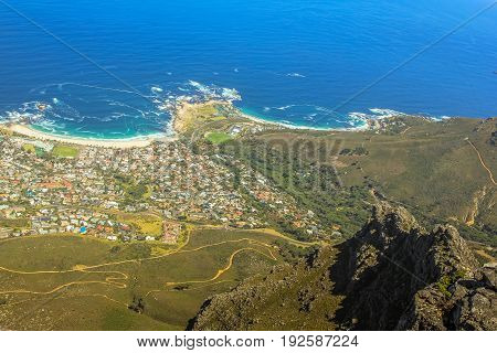Aerial view of Camp's Bay Beach near Cape Town as seen from Lion's Head within the Table Mountain National Park in South Africa, Western Cape. Camps Bay Beach is a great popular white sand beach.