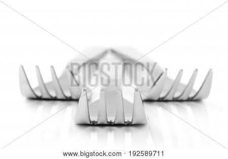 An abstract close up image of a group of forks on a white surface