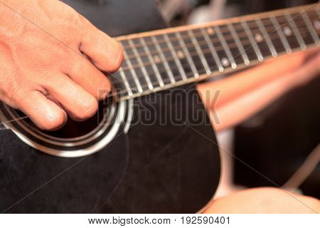 Men playing guitar and singing in Thailand.