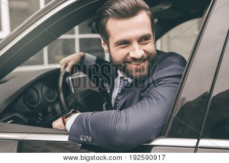 Young business person test drive new vehicle parking