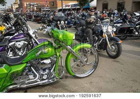 Sturgis South Dakota - August 8 2014: Riders in the main street of the city of Sturgis in South Dakota USA during the annual Sturgis Motorcycle Rally
