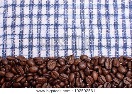 Texture Of A Colored Towel, A Towel Of A Cellular Type, On Which Lies A Certain Amount Of Brown Coff