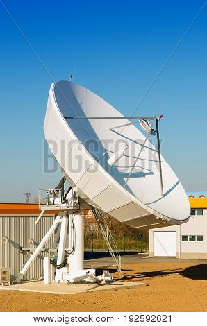 Satellite TV antenna in communication center . Telecommunications engineering