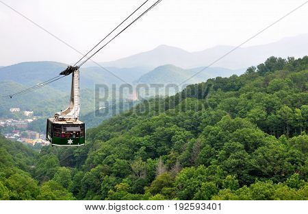 GATLINBURG, TENNESSEE- JUNE 9, 2011 - Tourists riding the scenic gondola cable car at Ober Gatlinburg in Tennessee