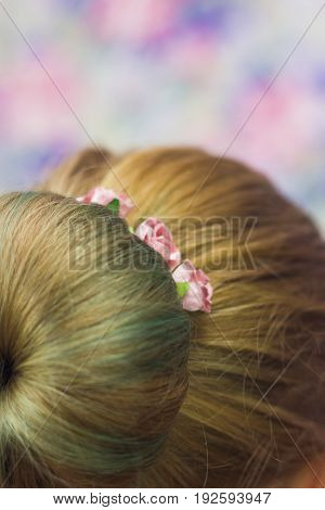 Girl With Topknot On Nape