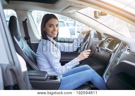 Woman transportation by modern eco car steering wheel