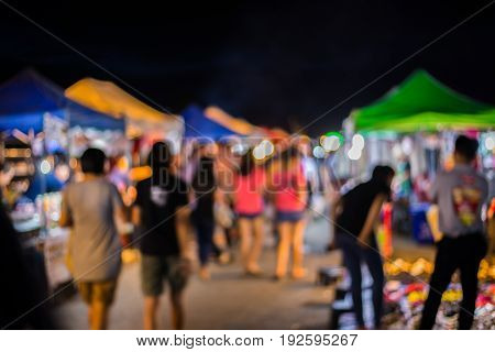 Blurry Image Of Night Market On Street Background With Bokeh