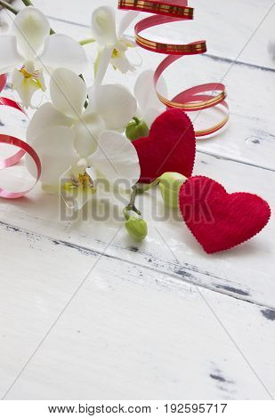Red hearts and orhid flowers.Valentines day consept.