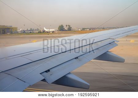 Airplane Wing On The Runway At Ben Gurion Airport On Sunrise