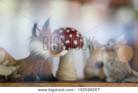 Dog miniature dolls looking dog lover kiss soft focus take a picture pass clear glass in showcase.