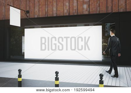 Man Walking Past Storefront