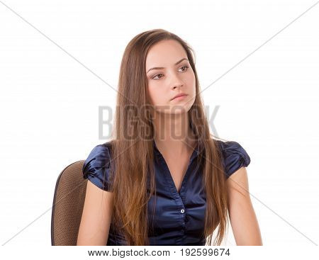 Headshot of a brown hair lady sitting in a chair.