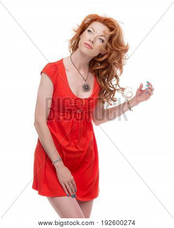 Redhead in a red dress looking upwards.