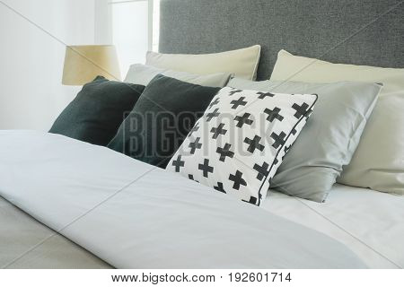 Modern Bedroom Interior With Pillows And Reading Lamp, Black And White Color Scheme