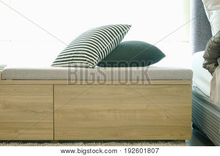 Wooden Daybed With Pillows Next To Bed
