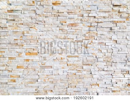 Modern and traditional yellow gold tile stone panel outdoor wall pattern background for retaining wall system exterior and interior design or decoration