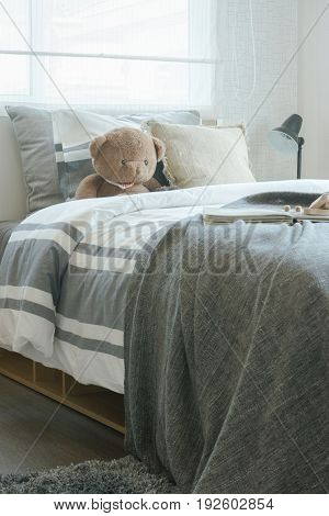 Brown Teddy Bear On Bed In Child's Modern Bedroom Interior