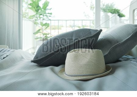 Hat And Pillows On Messy Bed In The Morning