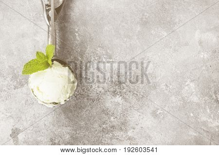 Mint Ice Cream In Spoon On A Gray Background. Top View, Copy Space. Food Background. Toning