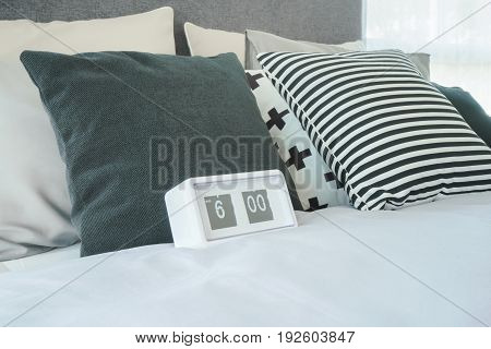 Stylish Bedroom Interior With Clock On Bed