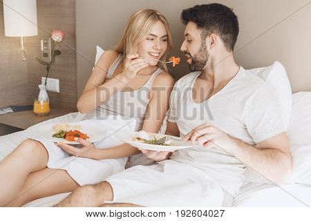 Young man and woman together tourism hotel morning breakfast