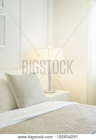 Modern classic bedroom interior with pillows and reading lamp