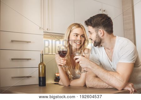 Young man and woman together tourism hotel kitchen