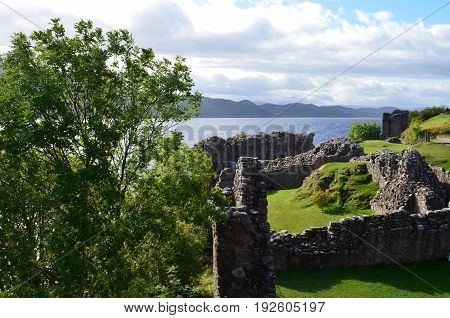 Stone ruins of Urquhart Castle overlooking Loch Ness in Scotland.