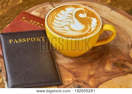 Coffee cup and passports. Documents on wooden board. Fun facts about passports.