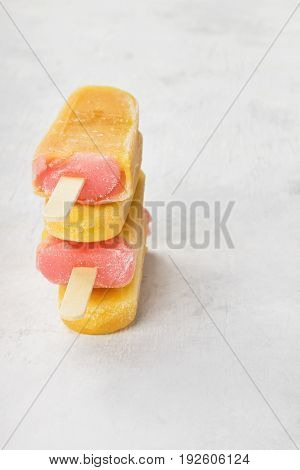 Multi-colored Popsicles On A White Background. Copy Space. Food Background