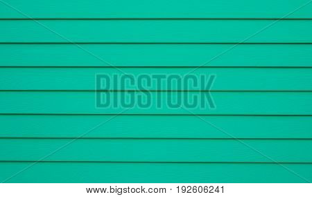 Light green surface is wooden lumber house bright color. This image can be use for background and decoration interior concept.