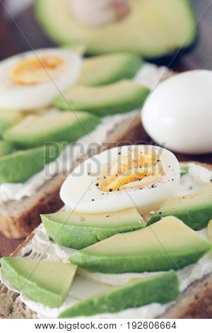 Avocado, Cream Cheese And Boiled Eggs On Wholemeal Bread - Shallow Dof