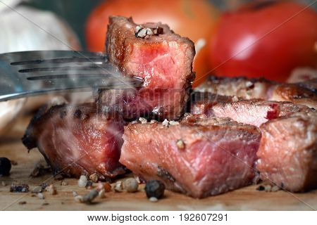 Medium Rare Beef Steak Grill In Charcoal Flamimg
