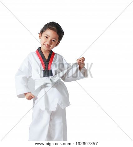 Happy Asian little girl smile and tie a white line in taekwondo uniform isolated on white background with clipping path with copy space