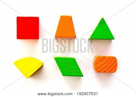 Set of wood shape toy block (square triangle trapezoid oval) on white background