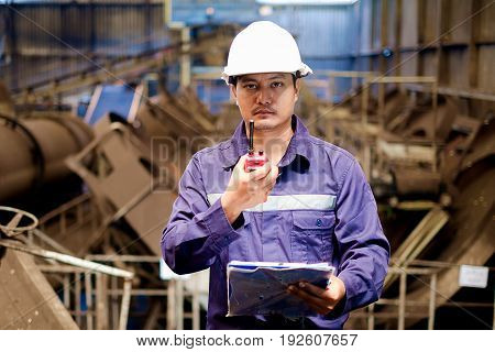 Engineer working in the production line process of granular coal plant