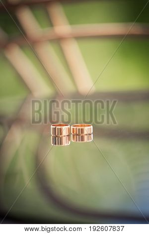 Wedding rings of the bride and groom on the table