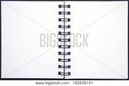 Blank double-spread spiral notebook isolated on white background.