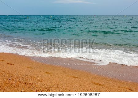Clean clear sea waves and beautiful sandy beach